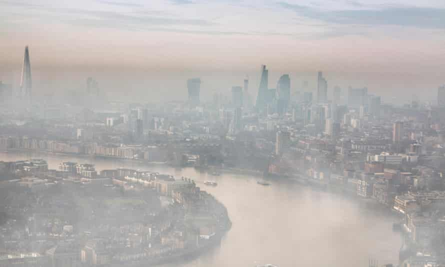 Mist and smog settle over the Thames and the City of London