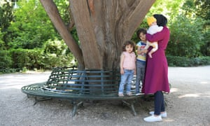 A refugee family who escaped war in Syria and now live in Athens: Maha with her three children