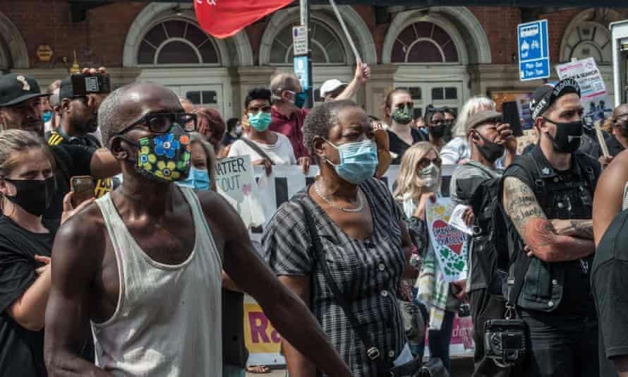 Black Lives Matter supporters demonstrate outside Tottenham police station in London on 8 August 2020.