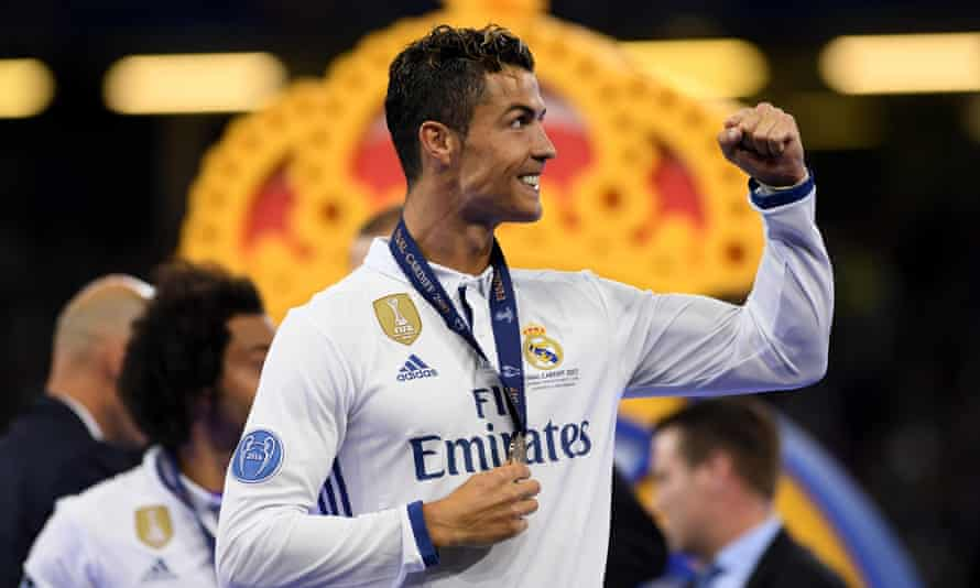 Cristiano Ronaldo with his winner's medal after the Champions League final, where he scored twice as Real Madrid won 4-1.