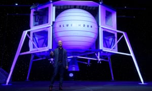 Jeff Bezos with a model of his Blue Moon lander.