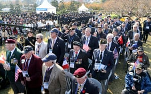 Veterans and their families of the 1950-53 Korean War offer a one-minute silent prayer at the UN Memorial Cemetery in the southern port city of Busan, South Korea