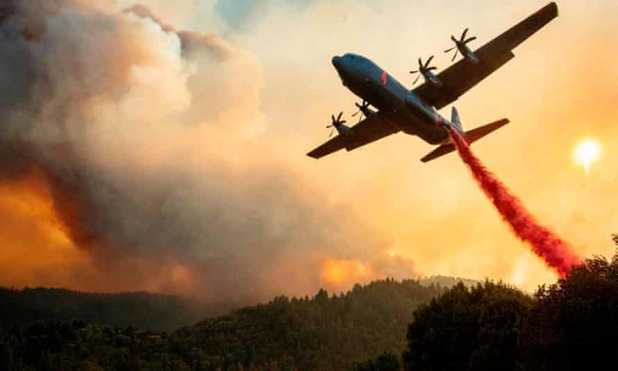 An aircraft drops fire retardant on a ridge during the LNU Lightning Complex fire in Healdsburg, California.