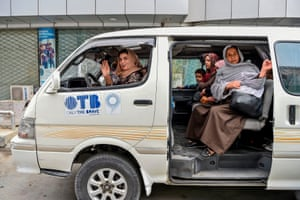 The taxi driver Razia Dalili waves as she sets off with her passengers. The new Pink Shuttle service helps women navigate a city with a woeful lack of transport options and where there is a high risk of harassment on the streets