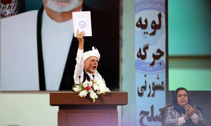 The Afghan president, Ashraf Ghani, shows the final draft of the Loya Jirga's decision on the release.