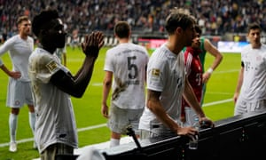 Bayern players recognise their supporters after the 5-1 defeat at Frankfurt – David Alaba would speak to a few of them face to face.