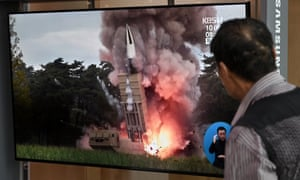 A South Korean man watches old footage of a North Korean missile launch. Pyongyang fired two projectiles towards the sea, hours after it gave a conditional offer to resume nuclear talks with the US.