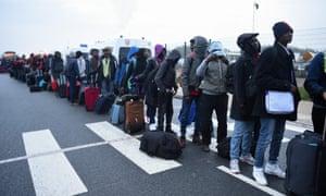 Men queue at an official meeting point