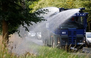 Bochum, Germany A police water cannon is used to combat drought
