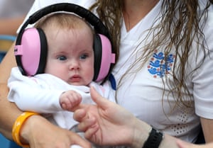 A young baby with pink noise-cancelling earphones during a group D match between England and Argentina at in Le Havre.