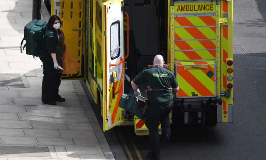 NHS ambulance staff arrive at a call out in London
