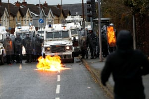 A small fire burns as protests continue