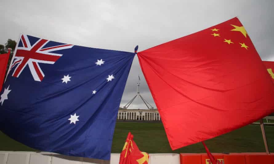 Australia's and China's flags on the front lawn of Parliament House in Canberra