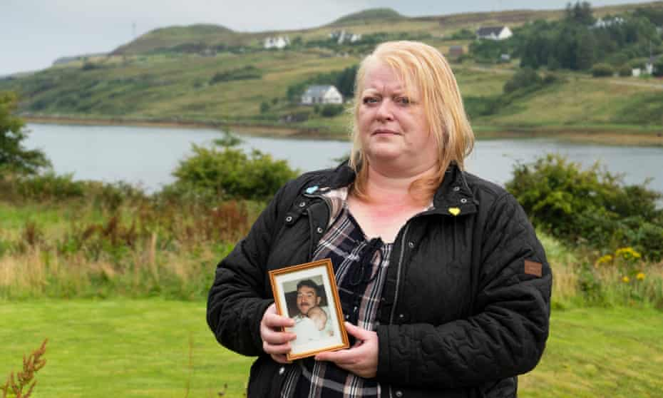 Mandie Harris with a picture of Colin … she had to watch him die through a window.
