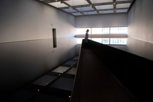 A visitor views Richard Wilson's 1987 work 20:50 at the Hayward Gallery's Space Shifters exhibition.