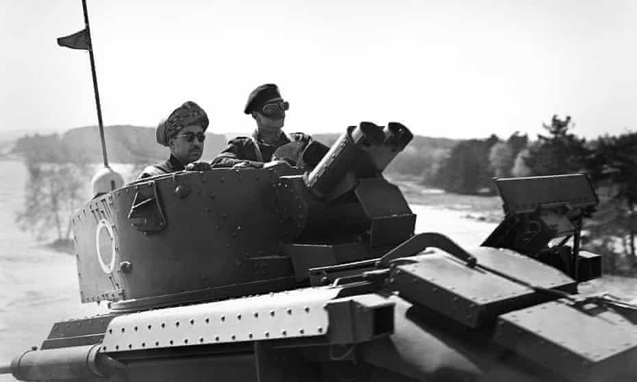 The Sultan of Oman, Said bin Taimur, watches troop manoeuvres at Aldershot in 1938
