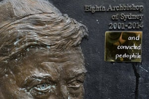 A plate reading 'and convicted paedophile' is seen on the plaque of former Sydney archbishop George Pell at St Mary's Cathedral in Sydney last week.