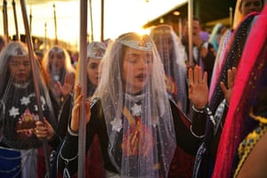 Nymphs, female devotees of the Vale do Amanhecer religious community, pray at the temple complex