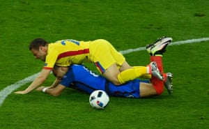 Dimitri Payet is floored by Adrian Popa.