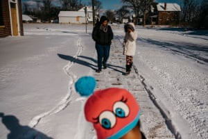 Kaiesha Rivers, center, walks with daughter Jyahri Pye, 11, during a portrait session on Sunday, Jan. 27, 2019 in Highland Park, Mich. Rivers had Jyahri at 32 weeks.