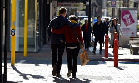 A couple embraces while walking in Wellington