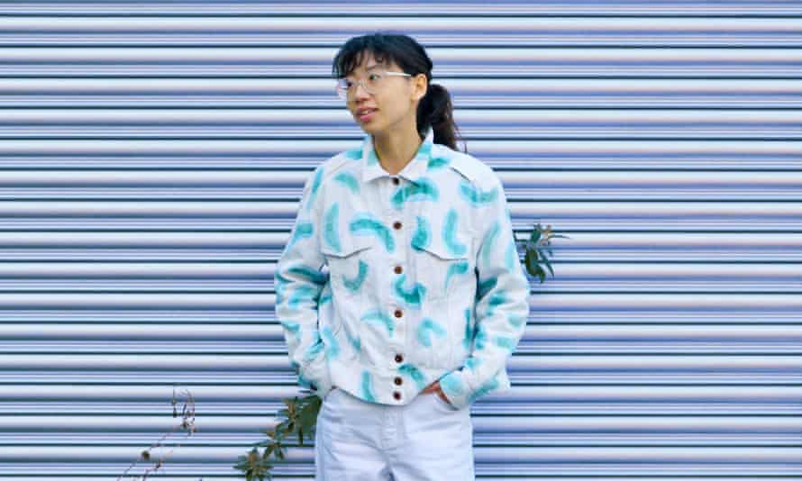 Dian-Jen Lin, co-founder of Post Carbon Lab, wearing their Euglena Print Jacket which has a living coating consisting of layers of photosynthetic micro-organisms that can turn carbon dioxide into oxygen.