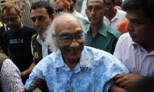 Shafik Rehman smiles as he placed under arrest in Dhaka.