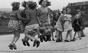 A group of girls skipping in a school playground in Wales, 1944.