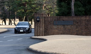 A car leaves the main entrance of the Kasumigaseki Country Club.