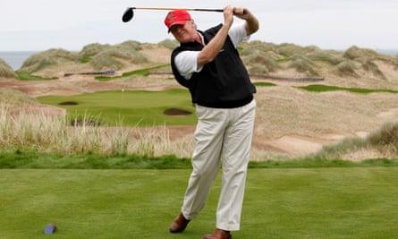 Donald Trump in red cap swinging golf club