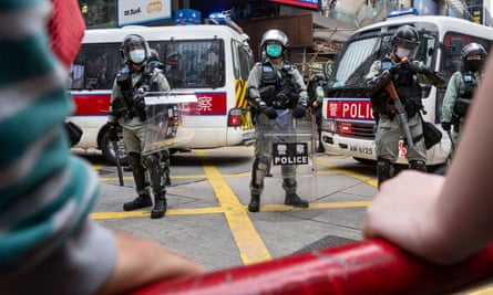 Riot police stand on guard in the middle of the Causeway Bay area during the the protest