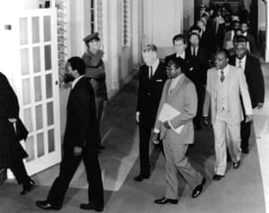 1980Ian Smith, prime minister of Rhodesia, with Robert Mugabe, centre, with Zimbabwean president Canaan Banana behind Mugabe in 1980