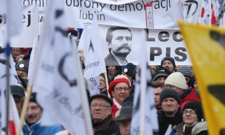 A portrait of Lech Wałęsa on one of the banners held by pro-democracy protesters on in Warsaw 27 February.