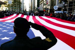 New York, USVeterans and war historians salute the flag during the Veteran's Day parade.