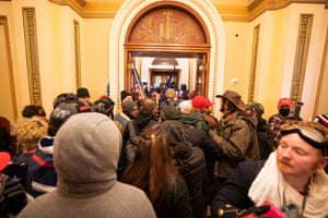 Supporters of US President Donald J. Trump outside the door to the House chamber after breaching Capitol security in Washington, DC, USA, 06 January 2021. Protesters entered the US Capitol where the Electoral College vote certification for President-elect Joe Biden took place.