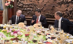 Russian president Vladimir Putin, China's Xi Jinping and Russian foreign minister Sergei Lavrov enjoy a business breakfast at the summit on Sunday.