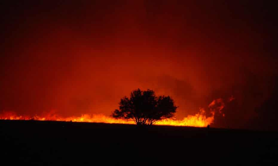 A bush blaze rages during the fight to save the township in February 2009 in Taggety, near Marysville.