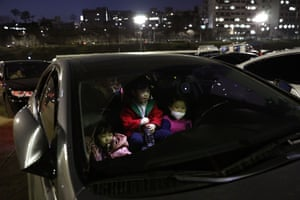 A family enjoy the movie from the safety of their car