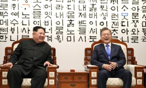 South Korean President Moon Jae-In (R) laughs with North Korean leader Kim Jong-Un (L) prior their summit meeting at the Peace House