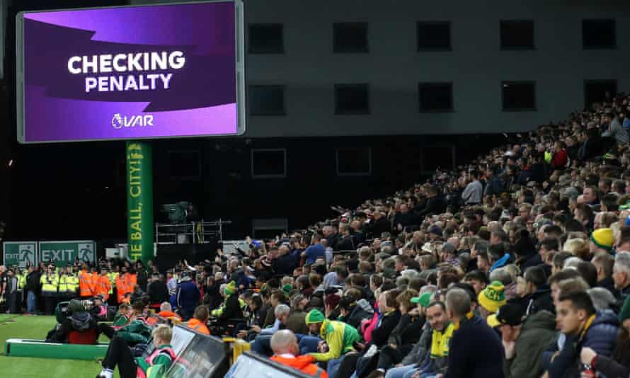 Spectators at Carrow Road wait for the VAR verdict in Norwich's game against Manchester United.