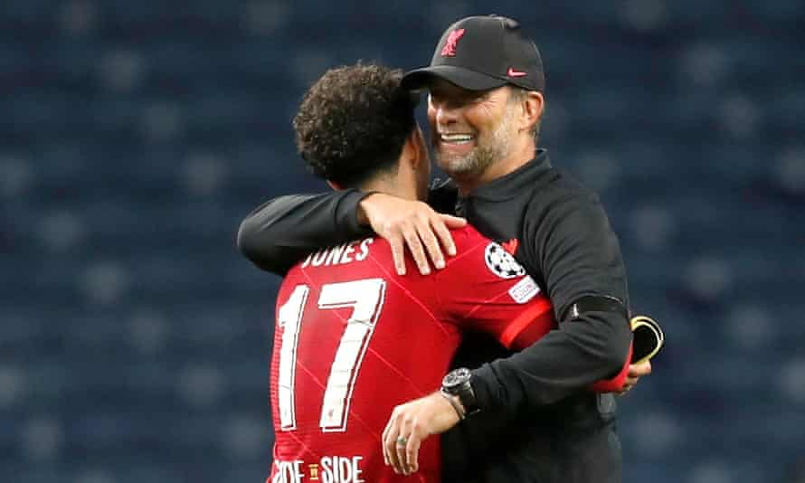 Curtis Jones is embraced by his manager Jürgen Klopp after the game in Porto.