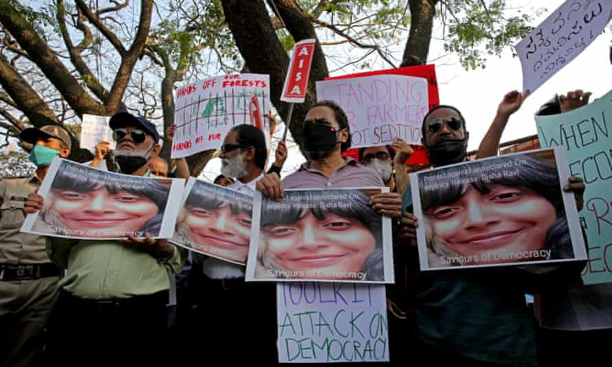 Activists hold placards and shout slogans calling for the immediate release of climate activist Disha Ravi in Bangalore