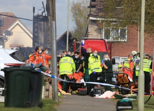 Willesborough, UKParamedics and emergency services attend to an injured person at the scene of a house fire in Mill View near Ashford in Kent following a reported explosion