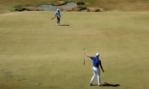 Rory McIlroy holes a huge birdie putt on the 13th green
