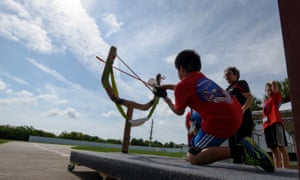 A camper does the slingshot to Mars activity during Camp KSC.