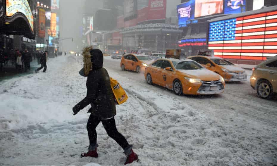 Pedestrians struggle through snow in downtown Manhattan.