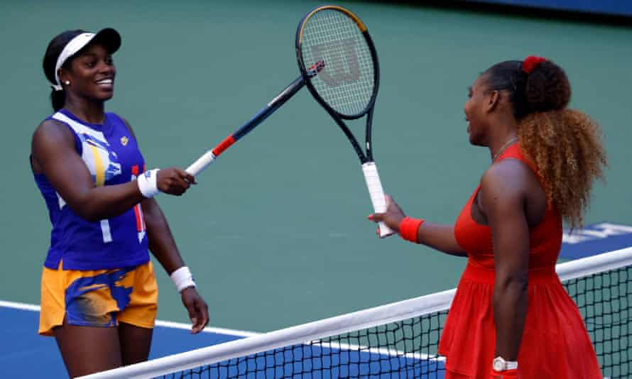 Serena Williams (right) taps rackets with Sloane Stephens after the match