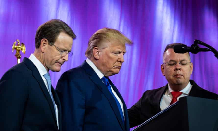 Trump prays between Tony Perkins, the president of the Family Research Council, and Pastor Andrew Brunson, at the council's annual gala in Washington in October.