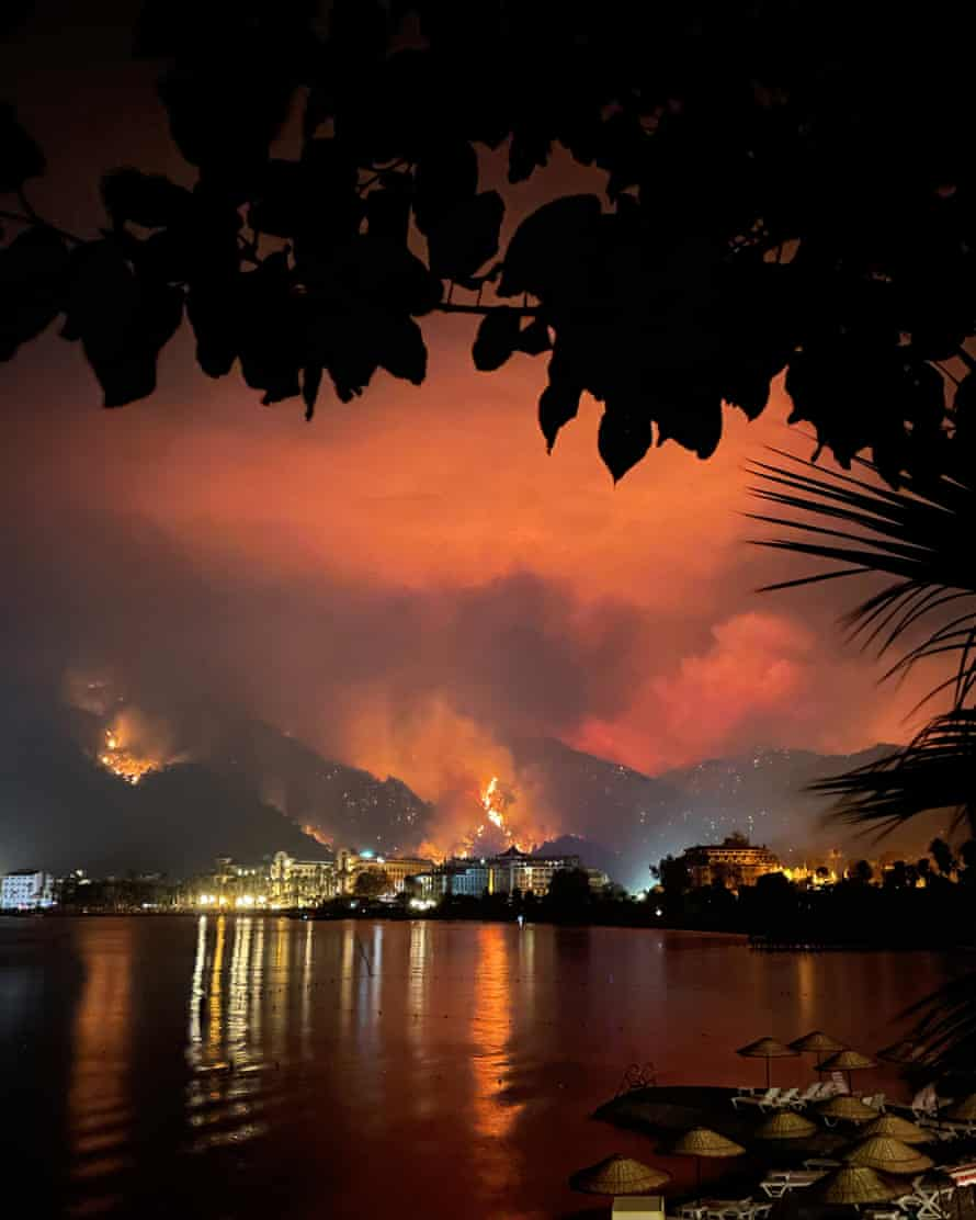 A wildfire in the hills behind Icmeler Bay, in Muğla province.