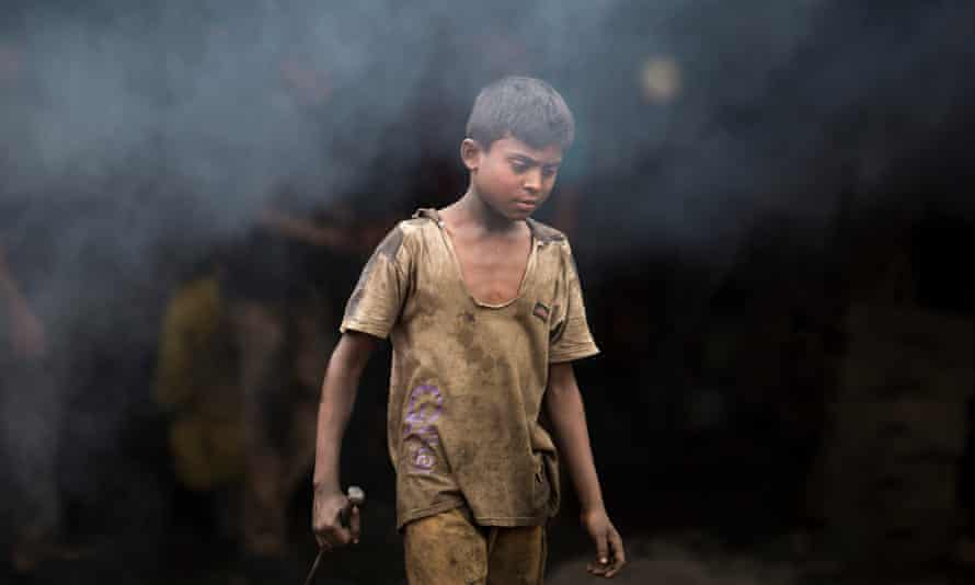 A child working in a ship propeller factory in Dhaka, Bangladesh.